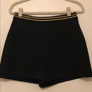 Dark blue shorts With gold detail